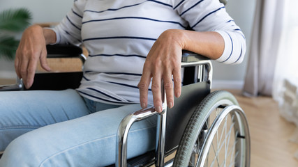 Fotomurales - Close up disabled older woman sitting in wheelchair