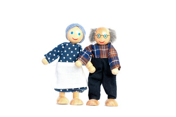 Dolls An elderly man and woman. Grandfather and grandmother hold the hand, a symbol of love and trust. Valentine's Day, love. On white background.