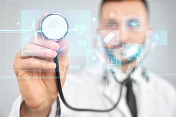 Doctor using stretoscope on virtual projection.