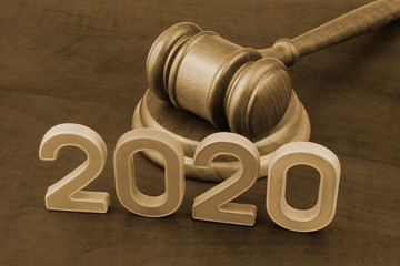 Wooden gavel and numbers 2020. New laws in year 2020 concept.