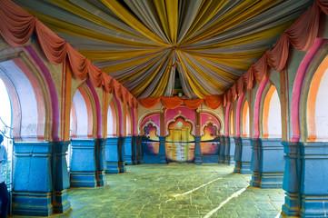 Indian hindu wedding mandap, decorations and interiors. Mandap setup in Hindu temple