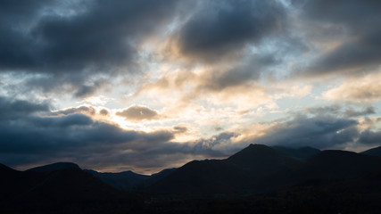 Foto op Canvas Nachtblauw Majestic Autumn Fall landscape image of view from Castlehead in Lake District over Derwentwater towards Catbells and Grisedale Pike at sunset with epic lighting in sky