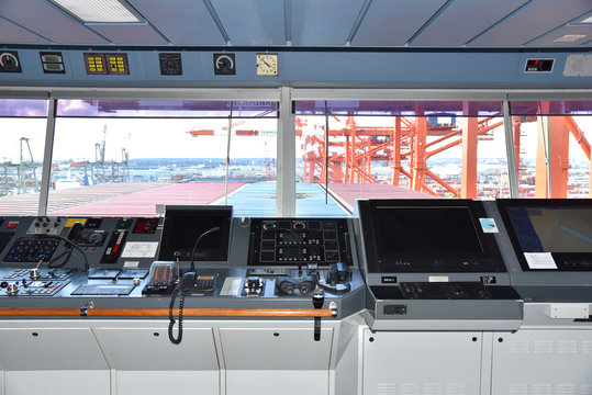 View of the control console on the navigational bridge of the cargo ship. Ship berthed in the port of Newark.