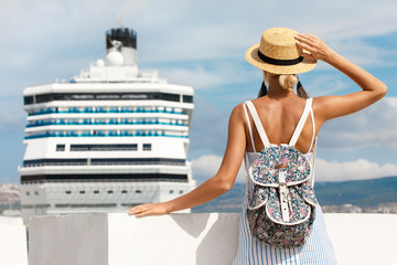 Woman tourist standing in front of big cruise liner, travel female
