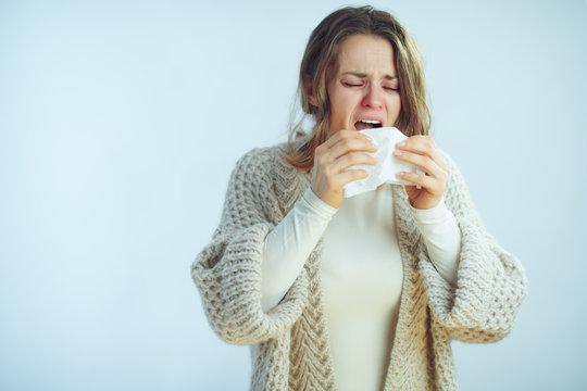 sick elegant housewife with napkin sneezing