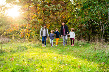 Mother and Father walking with their children in nature