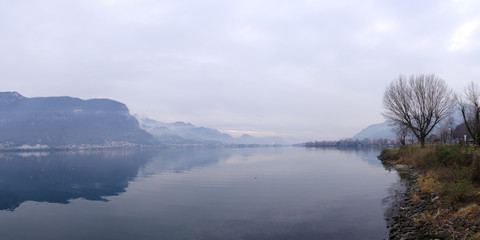 Pescate, Lecco, Lombardy, Italy, January 18, 2020 - Panoramic view on the southern side of the lake Garlate, which is connected to the lake Como through the river Adda at the foot of the Alps.