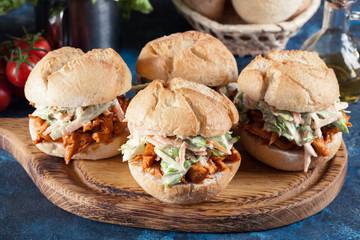 Foto op Plexiglas Snack Pulled chicken sandwich with salad and bbq sauce