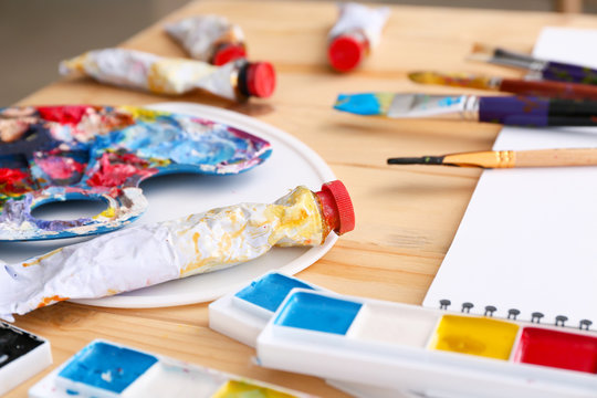 Set of artist's supplies on table
