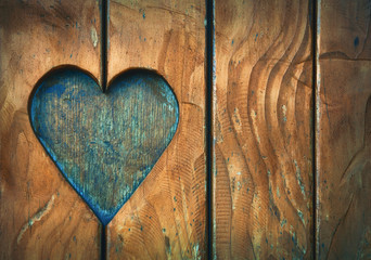 Fotobehang Retro One heart shape carved in vintage wood close up