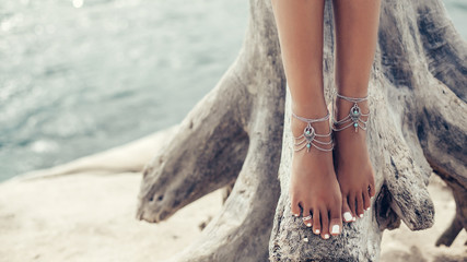 Deurstickers Boho Stijl Boho girl wearing indian silver jewelry on the beach