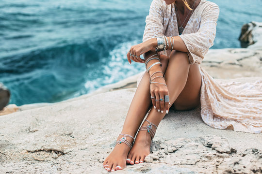 Boho girl wearing indian silver jewelry on the beach