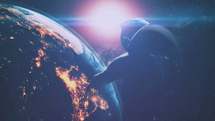 cosmonaut silhouette in outer space over illuminated Earth at bright coloured sunlight closeup. 3d animation. Science and technology concept. Elements of this product furnished by NASA