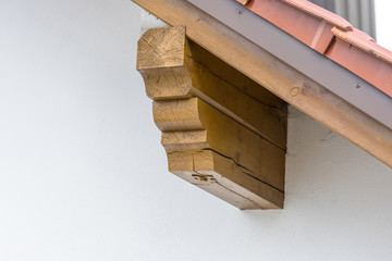 Detail of the beam roof construction of a finished residential house covered with roof slabs.