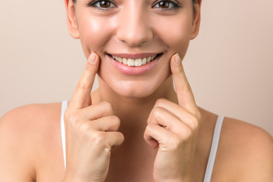 close up of a young woman beautiful smile, healthy lips and white teeth in high resolution