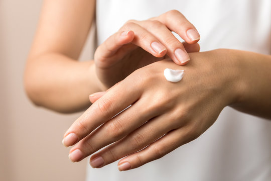 skincare. close up view of woman hand moisturising them with cream. skincare