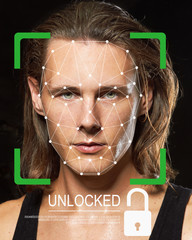 Biometric verification. Young man. The concept of a technology of face recognition on polygonal grid