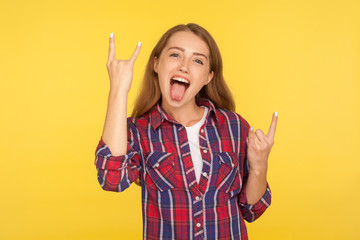 Yeah, that's crazy and awesome! Portrait of overjoyed excited ginger girl in checkered shirt...