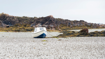 Fishing boat in the mudflat in St Clement´s Bay