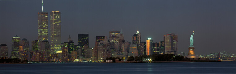 This is the downtown Manhattan skyline and Statue of Liberty. It is the view from New Jersey at...