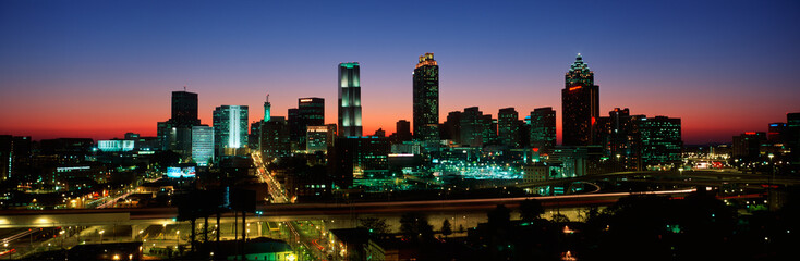 Fototapete - This is the skyline after the 1996 Olympics. It is the view at dusk.