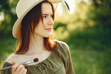 Woman in a summer field. Cute lady drawing. Girl with colorful paints