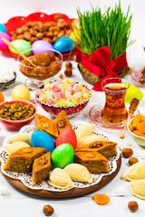 Autocollant pour porte Pique-nique Novruz Ramadan in Azerbaijan. Colored Eggs, Wheat Springs for Easter and Traditional Sweets. Selective focus.