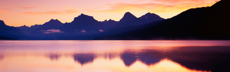 Wall Mural - This is Lake McDonald. There is a reflection of the mountains in the lake.