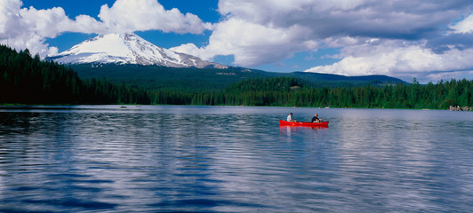 Wall Mural - This is snow capped Mount Hood and Trillium. There is a canoeist in a red canoe on the lake .