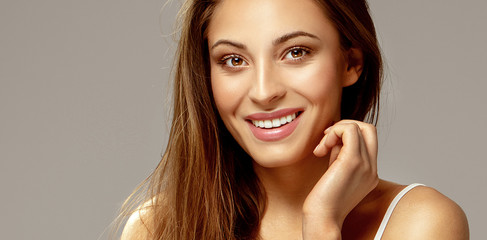 Cheerful young brunette smiling. Wall mural