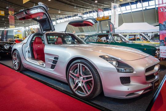 "STUTTGART, GERMANY - MARCH 18, 2016: Supercar Mercedes-Benz SLS AMG 6,3 Coupe, 2010. Europe's greatest classic car exhibition ""RETRO CLASSICS"""