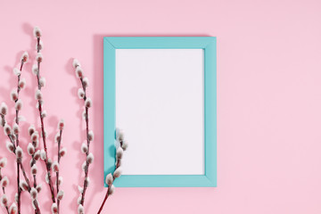 Beautiful flowers composition. Spring background. Photo frame, branches of pussy willows on pastel pink background. Valentines Day, Easter, Happy Women's Day, Mother's day.  Flat lay, top view