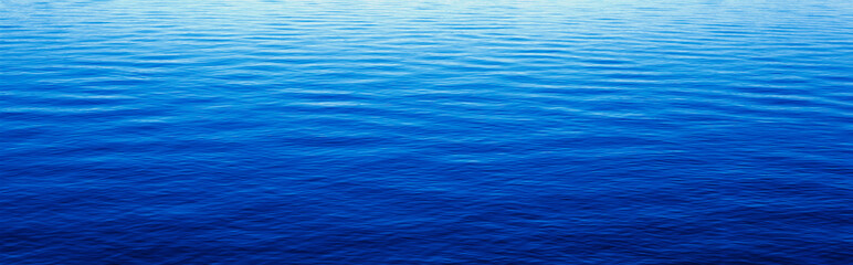 These are water reflections in Lake Tahoe. The water is a deep blue and the small ripples in the water form a pattern.