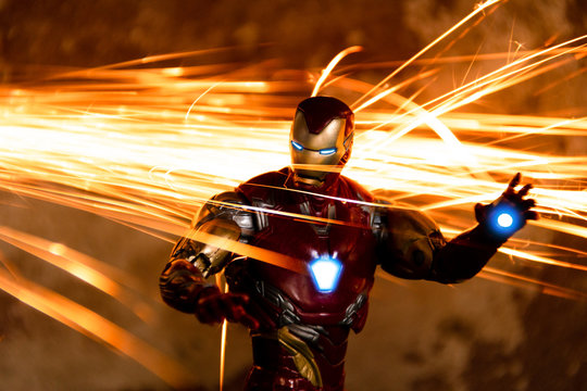 TOKYO, JAPAN - JANUARY 17, 2020 :  Fighting pose of Iron Man action figures in fire sparks. Iron Man is a fictional superhero appearing in American comic books published by Marvel Comics.