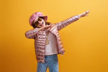 Kid on bright color background.