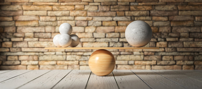 wooden scale balancing one big ball and four small ones on wooden floor