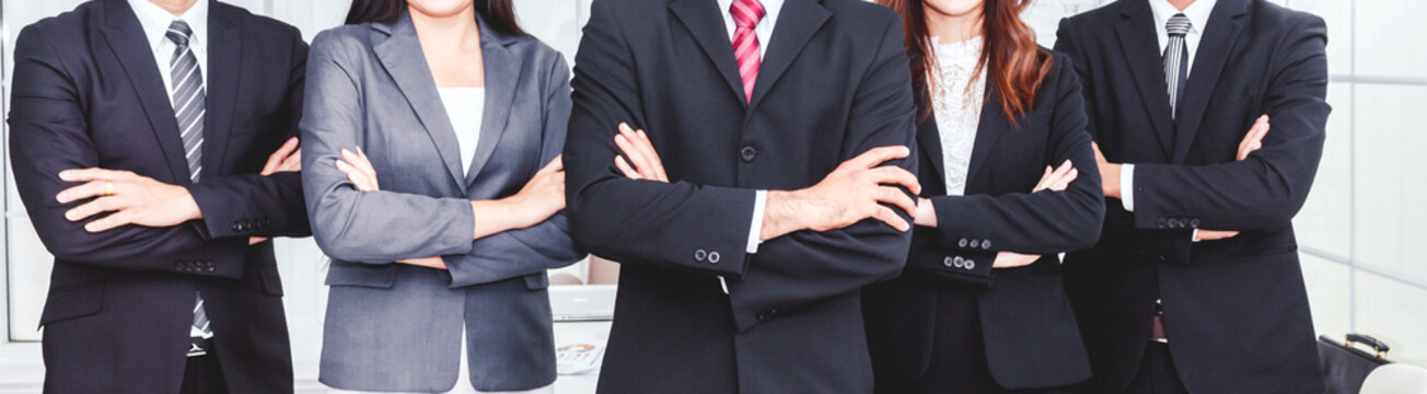 Successful professional group of business people man and woman team standing folded hand at office