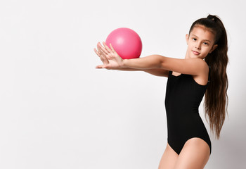 girl gymnast trains with a gymnastic ball . children professional sports. rhythmic gymnastics.