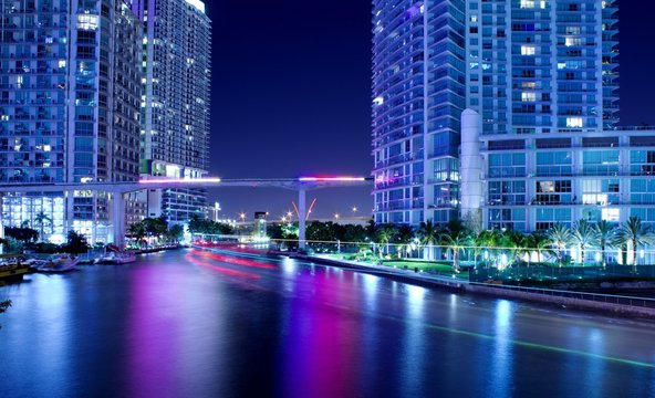 bright city lit up at night, downtown miami florida, long exposure