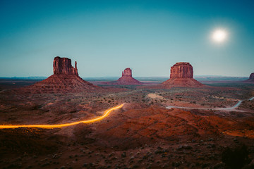 Wall Mural - Monument Valley with light trails at night, Arizona, USA