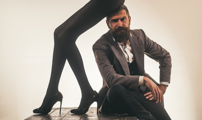 bearded man in formal suit. female legs in sexy shous. office romance. couple in love. businessman. striptease. Special evening. Lovely date. Lovely atmosphere. Only love can warm us. Happy