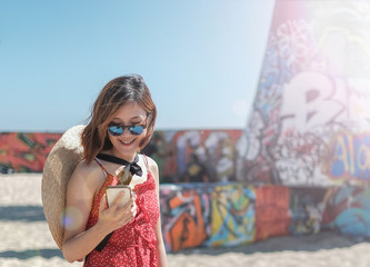 millennial  woman use the mobile and technology for digital lifestyle travel and happy life.