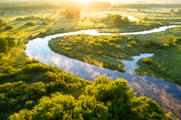 Summer morning on the river with fog, aerial view. River located between forest and green fields Fototapete