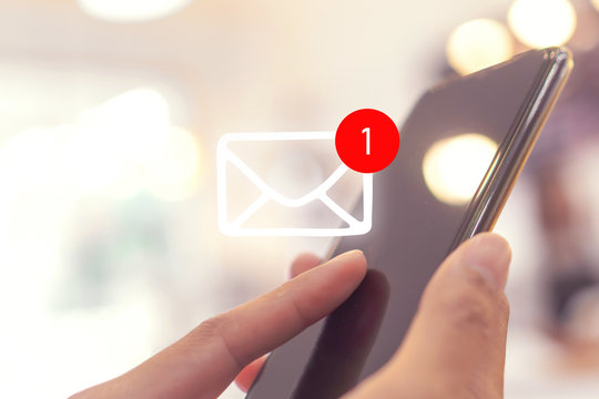 Woman hand use smartphone in public area with 1 new email alert sign icon pop up. Communication business technology.