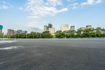 empty urban road with modern building in the city.