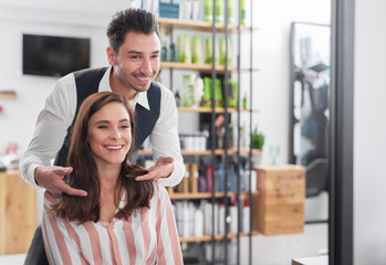Hairstylist and female customer in hair salon