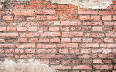 Old weathered brick wall fragment texture background