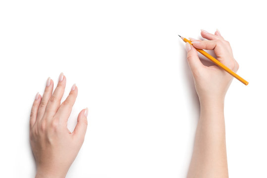 Female hands holding pencil, isolated on white background. File contains a path to isolation.