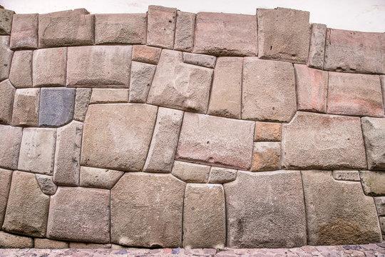 Incredible Inca Wall on Hatun Rumiyoc Street, Famous Ancient Street in Cusco, Peru