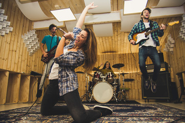 Young band music playing a song in a recording studio